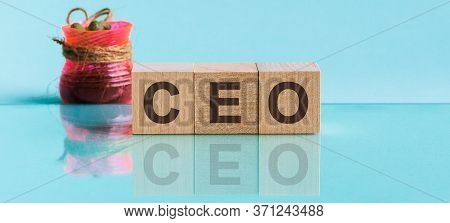 Ceo - Word From Wooden Blocks With Letters, To Divide Or Use Something With Others Share Concept, Bl