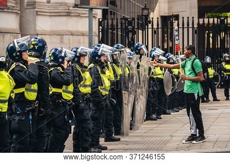 London / Uk - 06/13/2020: Black Lives Matter Protest During Lockdown Coronavirus Pandemic. Young Man