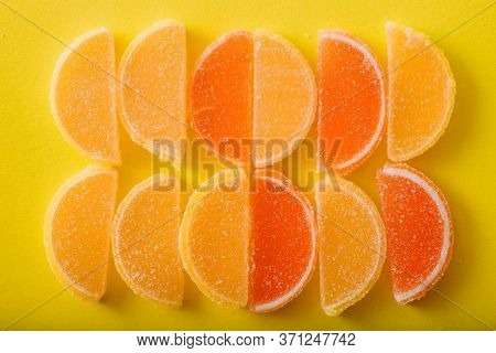 Multi-colored Marmalade Jelly Candys. Dessert Marmalade In The Form Of Lemon And Orange Slices. The