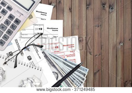 Irs Form 1099-misc Miscellaneous Income Lies On Flat Lay Office Table And Ready To Fill. U.s. Intern
