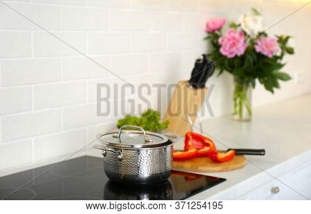 New Saucepot On Induction Stove In Kitchen