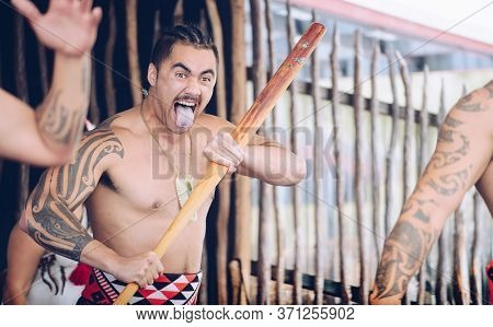 Rotorua, New Zealand -december-11-2017 : Maori Tribes Traditional War Cry. The Maori Are The Indigen
