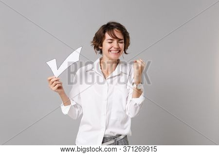 Happy Young Business Woman In White Shirt Posing Isolated On Grey Wall Background In Studio. Achieve