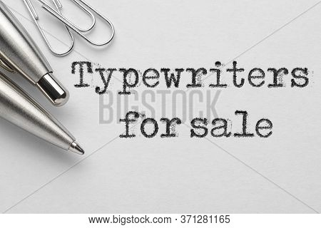 Typewriters For Sale Words Typed Near Metal Ballpoint Pen And Paper Clips