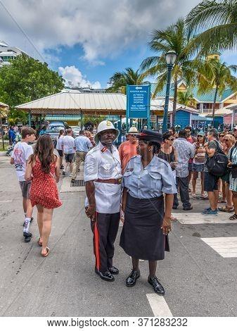 Nassau, Bahamas - May 3, 2019: Two Royal Bahamas Police Officers (man And Woman) Are Keeping Order I