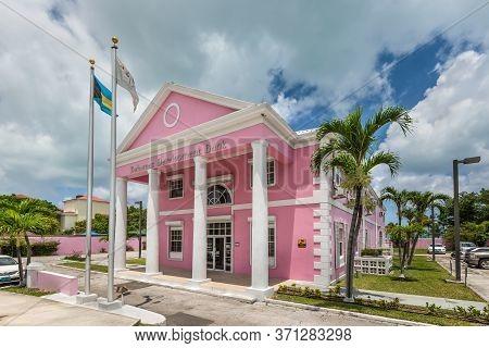 Nassau, Bahamas - May 3, 2019: Pink Building Of Bahamas Development Bank In Nassau. The Bahamas Deve