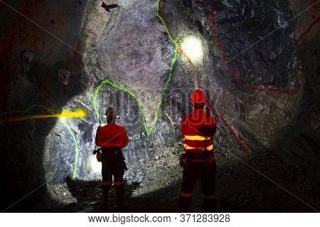 Underground Miners In Ore Tunnel - Australia