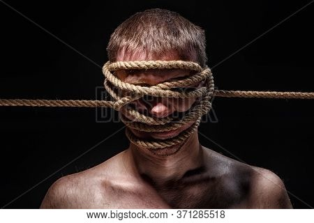 Photo Of Binded Man With Rope On Face