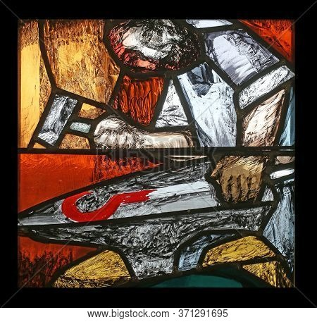 SONTBERGEN, GERMANY - OCTOBER 20, 2014: Moses, the journey of the nation at the end of the day on Mount Sinai, detail of stained glass window by Sieger Koder in Saint James church in Sontbergen