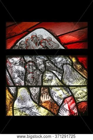 SONTBERGEN, GERMANY - OCTOBER 20, 2014: The journey of the nation at the end of the day on Mount Sinai, detail of stained glass window by Sieger Koder in Saint James church in Sontbergen, Germany