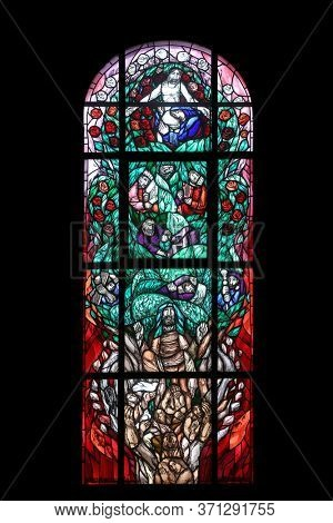 HOHENBERG, GERMANY - MAY 06, 2014: Jesus' Genealogy, stained glass window by Sieger Koder in St. James church in Hohenberg, Germany