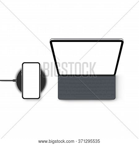 Tablet Computer With Keyboard And Smartphone On Wireless Charger, Isolated On White Background. Mode