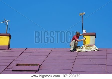 To Paint A Chimney, Man Paints The Chimney At Home With A Brush