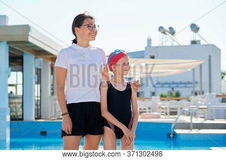 Family, Sport, Swimming, Health, Lifestyle Concept. Portrait Of Mom And Kid Daughter Wearing Swim Go