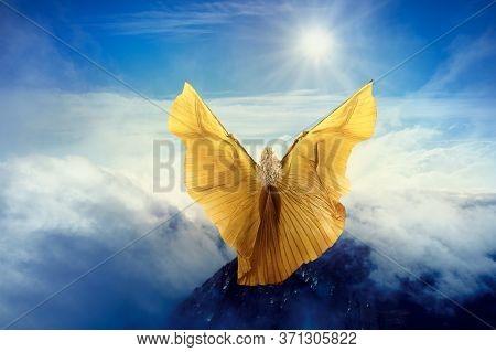 Woman Butterfly Wings Flying In Sky Clouds, Girl Standing On Mountain Peak Ready Flight To Sun