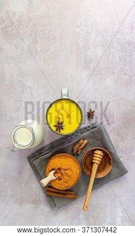 Ayurveda Golden Turmeric Milk With Ingredients. Vertical Orientation, Flat Lay, Copy Space.