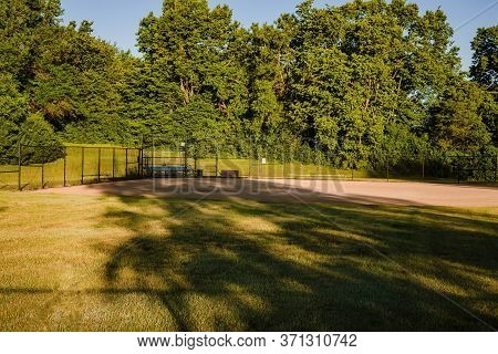 View From The Outfield Of A Youth Baseball Field In A City Park