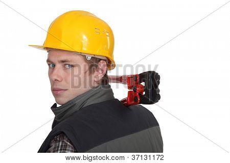 Man holding bolt cutter over shoulder