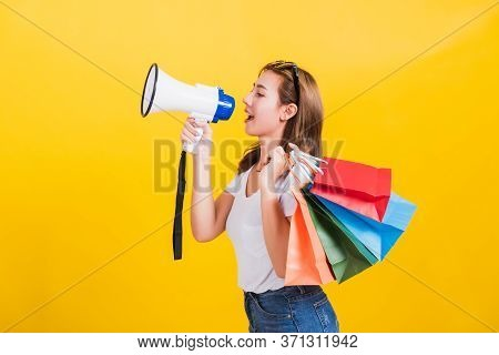 Portrait Asian Thai Beautiful Happy Young Woman Smiling Hold Shopping Bags Multi-color And Shouting