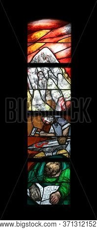 SONTBERGEN, GERMANY - OCTOBER 20, 2014: The journey of the nation at the end of the day on Mount Sinai, stained glass window by Sieger Koder in Saint James church in Sontbergen, Germany