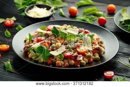 Mini Potato Gnocchi Tricolour With Tomato, Spinach, Seasonal Salad Leaves And Parmesan Cheese