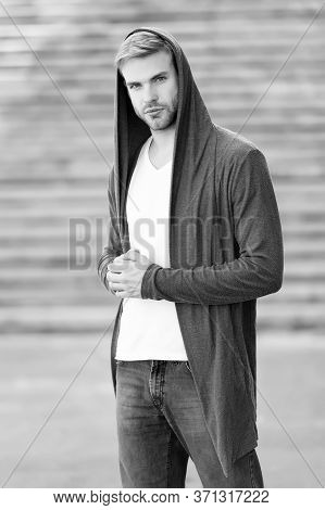 Male Fashion Influencer. Fashionable Young Model Man. Carefree Guy Street Style Outfit With Hood. Ha