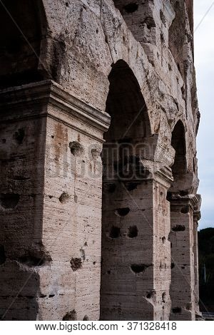 Close Up On The Columns Of The Coliseum In Rome, Italy