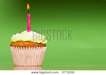 Small Green Cake With A Single Candle