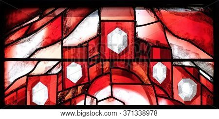 PIFLAS, GERMANY - JUNE 07, 2015: God cares for His own and strengthens them in their life path, detail of stained glass window by Sieger Koder in St. John church in Piflas, Germany