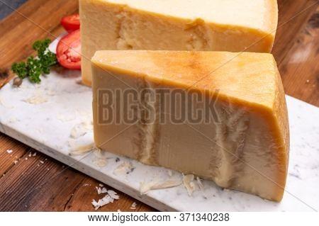 Big Wedge Of Parmigiano-reggiano Parmesan Hard Italian Cheese Made From Cow Milk Or Grana Padano  Cl