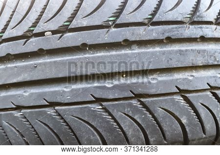 Damaged And Worn Old Black Tires On A Stack. Tire Tread Problems. Solutions Concept. Tire Tread Prob