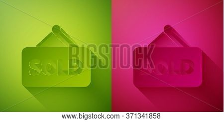 Paper Cut Hanging Sign With Text Sold Icon Isolated On Green And Pink Background. Sold Sticker. Sold