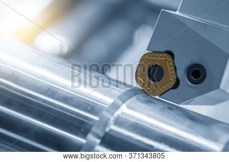 Close-up Scene  Cutting Tool Of Cnc Lathe Machine.the  Chip Insert Of Turning Tool .the Cnc Lathe Ma