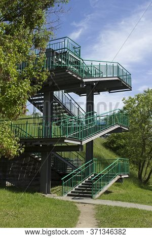 Metal Green Multi-level Staircase, Transition On The Street To The Bridge Or Across The Road