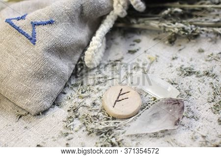 Scandinavian Wooden Rune Fehu, Fe, Feoh On A Rough Linen Cloth With Amethyst Crystalline, Rock Cryst
