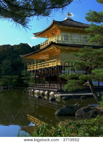 The Golden Pavilion Temple reflected in a pond in the foreground. Kyoto Japan poster