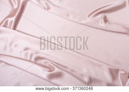 Pink Satin Fabric. Textile Background. Powdery Color. Waves And Folds Of Fabric.