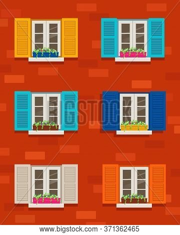 Windows With Colored Shutters And Flowers In Pot On  Brick Wall. Traditional Italian Windows On A Bu