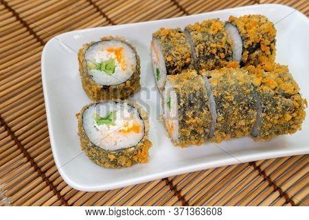 Baked Sushi Rolls Close-up. Unagi And Flying Fish Roe, Futomaki Asi. Dish Of Japanese Cuisine