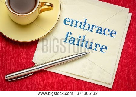 embrace failure inspirational reminder - handwriting on a napkin with a cup of coffee, business or personal development concept