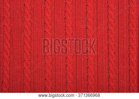 Knitted Background. Knitted Red Texture. A Knitting Pattern Of Wool. Knitting. Background.