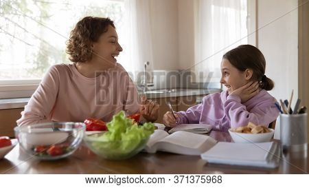 Smiling Mom And Teen Daughter Busy With Daily Activities