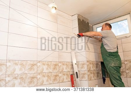 The Builder Measures The Distance On The Ceramic Tile Using A Measuring Tape. Distance Measurement W