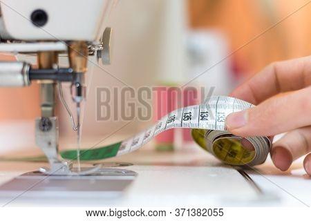 Dressmaker Workshop: Close Up Of Measuring Tape, Needles And Thread