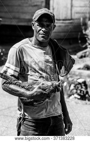June 2, 2020 Ocoa, Dominican Republic. Dramatic Black And White Image Of Dominican Man With His Figh