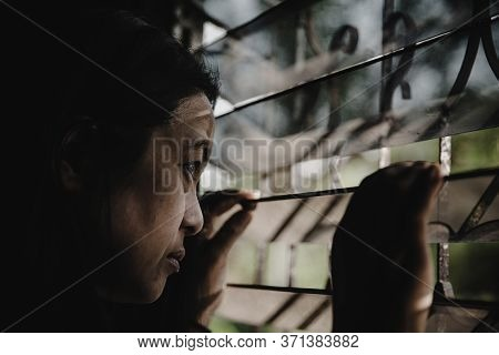 A Woman Trapped In A Prison Jail Cell.