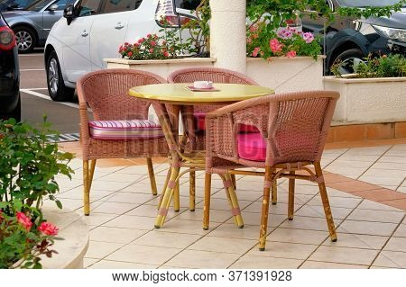 Empty Patio In Summer In Recreation. Pink Table And Armchairs On Outdoor Terrace Of Summer Cafe.
