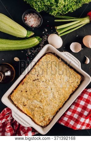 Zucchini Casserole On Dark Background. Dietary, Low-calorie, Healthy Food. Homemade Casserole From S