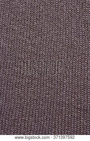 Knitted Mauve Background. Knitted Purple Textiles For Text. The Texture Of A Wool Sweater. Hand Knit