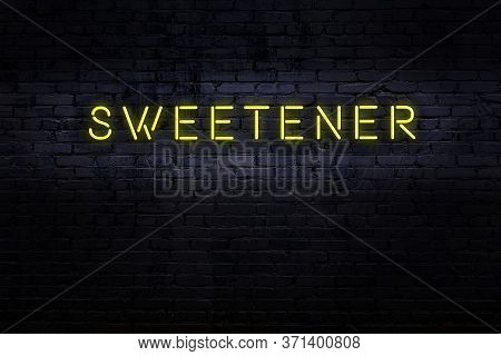 Neon Sign On Brick Wall At Night. Inscription Sweetener